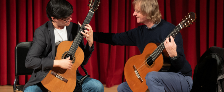 Guitarist David Russell works with UW guitar student Max Schaeffer (Photo: Dean Ritz).