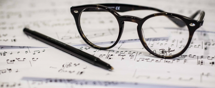 glasses on sheet music (photo: Dayne Topkin)