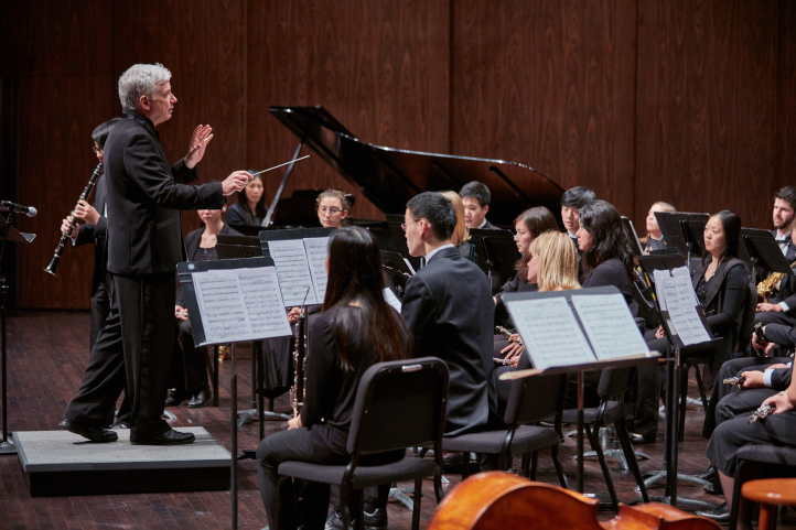 Timothy Salzman conducts the UW Wind Ensemble (photo Steve Korn)