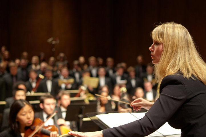 Giselle Wyers conducting the combined UW symphony and choirs (Photo: Steve Korn).