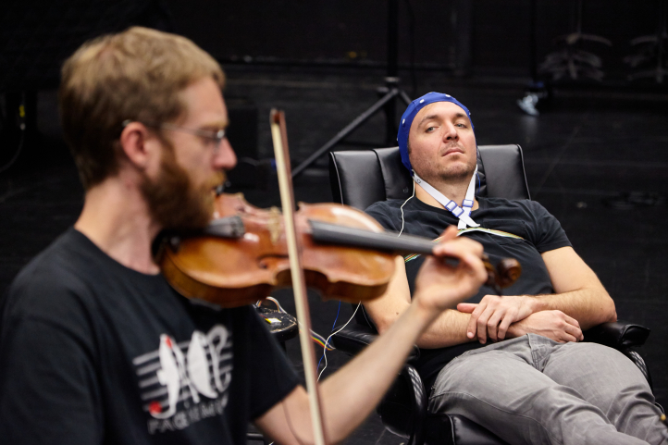 Music/DXARTS postdoc Marcin Pączkowski prepares JACK Quartet violinist Austin Wulliman for an EEG session