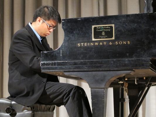 Graduate piano student Andrew Chen performs in Brechemin Auditorium.