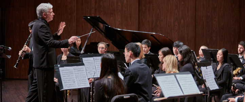 Timothy Salzman conducts the UW Wind Ensemble (photo Steve Korn)
