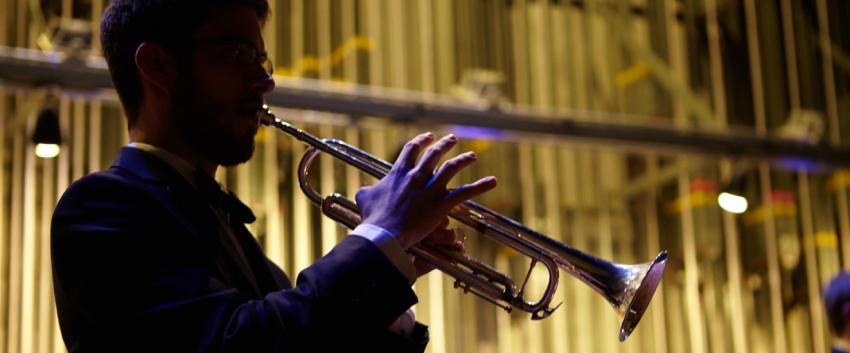 Back-lit trumpet player