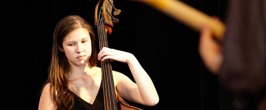 Jazz Studies major Carmen Rothwell, bass, in performance at the 2013 Improvised Music Project Festival (Photo: Steve Korn).