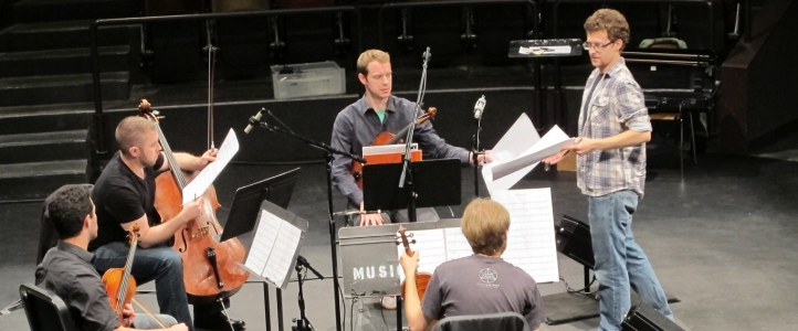 Composition student Josh Archibald-Seiffer receives notes from the JACK Quartet