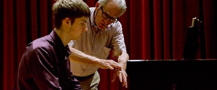 Craig Sheppard works with piano student