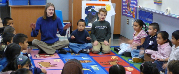 UW Music Education student working with school children in the Yakima Valley in 2009.