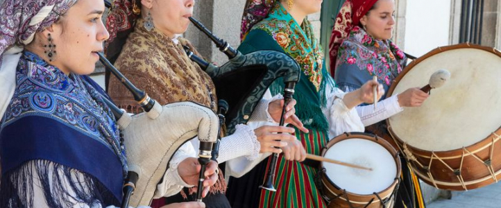 "Via Getty: ""A group of young women in traditional costumes play Galician music with bagpipes, tambourines and drum in the historic center during the San Froilan festivities on October 6, 2019 in Lugo, Galicia, Spain."" ( Xurxo Lobato/Getty Images)"