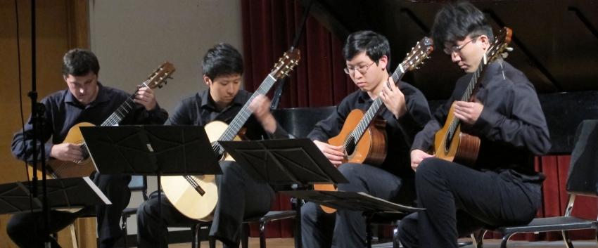UW Guitar Ensemble students playing guitars