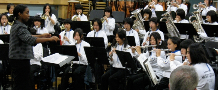 Music Education students teaching Musico Grato, a visiting school group from Himi, Japan