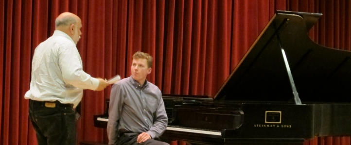 Graduate piano student Joseph Dougherty takes part in a master class with guest artist Stuart Isacoff.