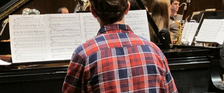UW music student in rehearsal with the Wind Ensemble.