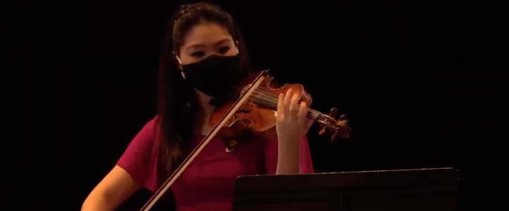 Faculty violinist Rachel Lee Priday performing masked at Meany Hall (Photo: School of Music).