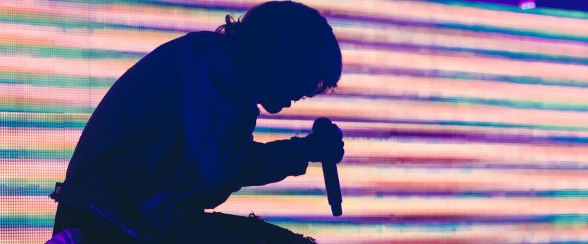 Singer bathed in purple light