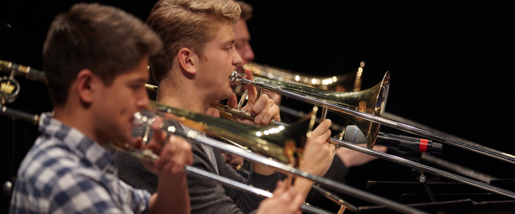 UW Studio Jazz Ensemble: Big Band, trombone players (photo: Steve Korn)