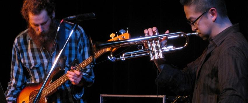 Cuong Vu Trio members Luke Bergman and Cuong Vu at IMPFest (2010).