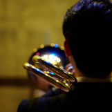 Trombonist viewed from behind