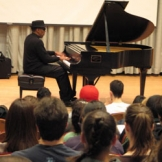 Piano player in Brechemin Auditorium