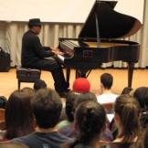 Piano player in Brechemin Auditorium