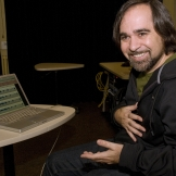 Composer Juan Pampin develops new technology in his laboratory at the Center for Digital Arts and Experimental Media to achieve his artistic ambitions (Photo: Mary Levin).