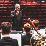 Timothy Salzman directs the UW Wind Ensemble.