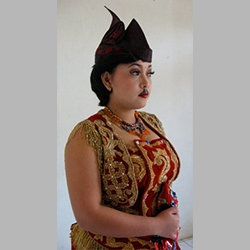A female dancer models the costume for the male-style dance Ngremo Tayub. Photo by Christina Sunardi.