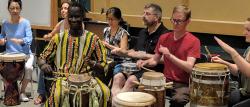Teachers drumming during the world music pedagogy workshop.