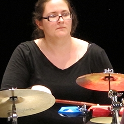 Female student playing the drums - percussion ensemble