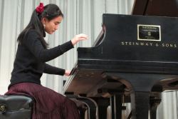 Piano student Rose Cheng performs in a master class for guest artist Paul Roberts.