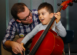 Young boy learning cello