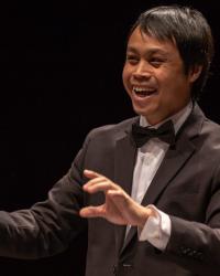 Chris Mathakul, graduate student conductor