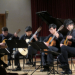 UW Guitar Ensemble students playing guitars