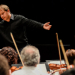 Ludovic Morlot conducting a side by side concert featuring the Seattle Symphony and UW Symphony Orchestra.