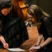 Young composers work at Benaroya Hall.