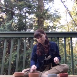Percussion Studies student Sophia Schmidt performs a flower pot improvisation.