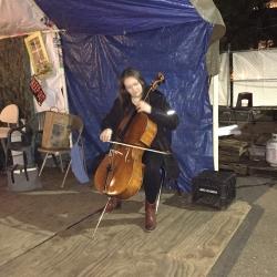 Faculty cellist Sæunn Thorsteinsdóttir performs at Tent City 3.