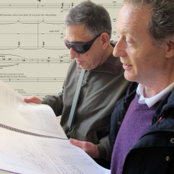 Professors Joël-François Durand (right) and Larry Starr peruse the score of Durand's new commission for Seattle Symphony (Photo: Joanne DePue).